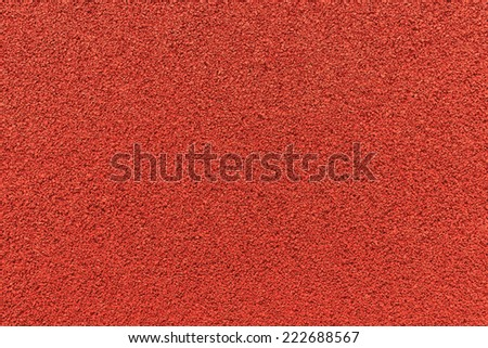 Close up of red rubber floor background.