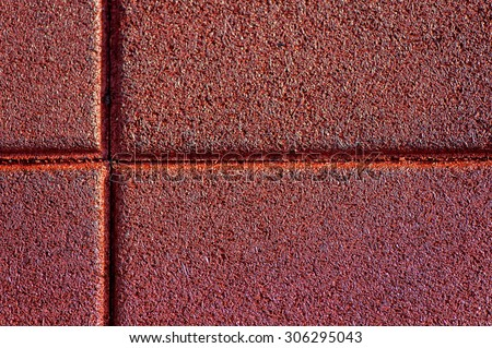 Close up of red used and old rubber floor of children play ground