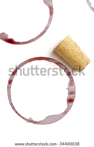 close up of red wine marks and cork on white background