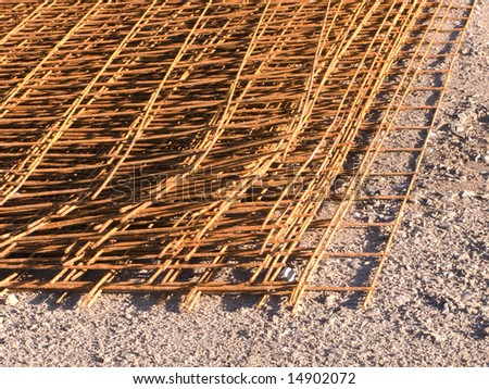 Close-up of reinforcing steel bar lying on ground