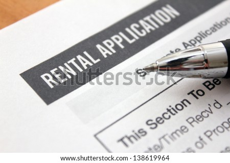 close up of rental application with pen