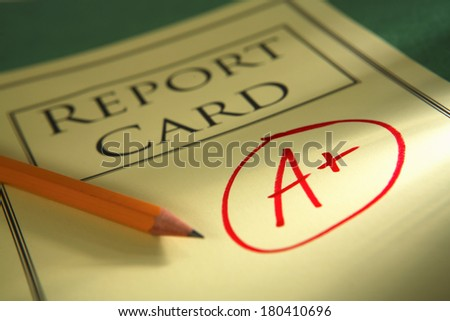 close up of report card with A+ and pencil