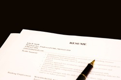 close-up of resume and pen