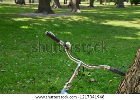 Close up of retro bicycle handlebar  in summer city park, Helsinki, Finland. #1217341948