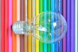 Close up of retro classic light bulb color pencil background.