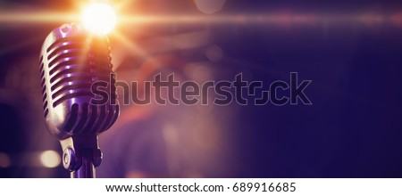 Close-up of retro microphone at concert - Shutterstock ID 689916685