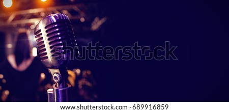 Close-up of retro microphone at concert in nightclub