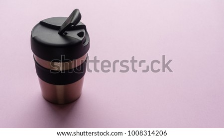 Close up of reusable coffee cup on pink background from above #1008314206