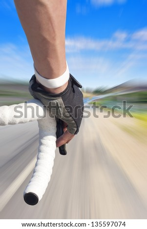 Close up of road bike rider with motion blurred roadway #135597074