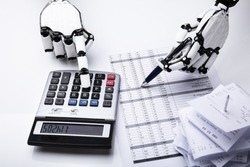 Close-up Of Robot Examining Financial Report With Calculator On Desk