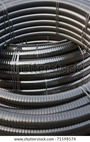 Close up of roll of cable in black plastic isolation