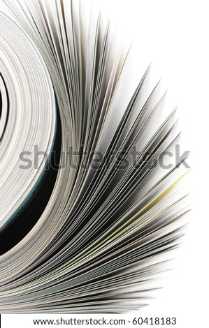 Close-up of rolled magazine isolated on white background.