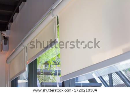 Close-up of roller blinds or curtain at the glass window Foto stock ©