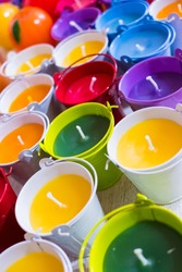 Close up of roma candles with colorful wax. Candle background.