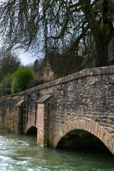 Close up of Roman Bridge over River Coln, Bibury