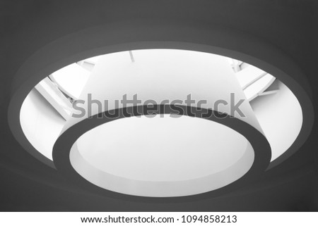 Close-up of roof window. Abstract modern architecture detail in minimalism style. Round backlit structure on the subject of contemporary building design. #1094858213