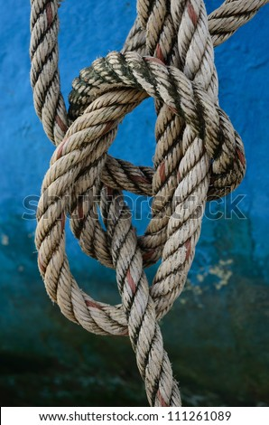 Close up of rope with a knot on fisherman's boat. #111261089