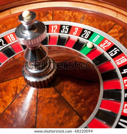 Close up of roulette with ball on zero