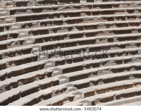 Close up of rows of seats and stairway, ancient Roman basalt open amphitheatre, Bosra, Syria