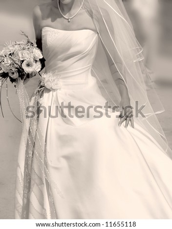 close up of running bride with bouquet, sepia