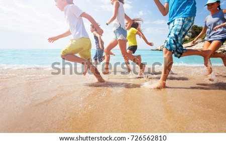 Close-up of running kids legs in shallow sea water #726562810