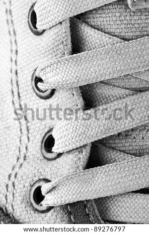 Close-up of running shoe laces. In B/W