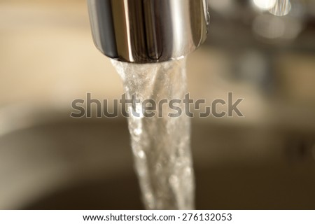 Close-up of running water from a faucet. #276132053