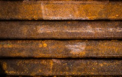 Close up of rusty metal iron bar.The background of rusty iron bars.Iron battens filled with rust.