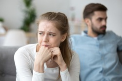 Close up of sad woman cry after fight with husband, unhappy young wife feel lonely having disagreement with spouse, upset female look in distance thinking of relationships problems or breakup