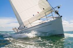 Close up of sailing boat, sail boat or yacht at sea