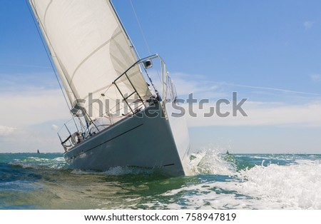 Close up of sailing boat, sail boat or yacht at sea on summer day with blue sky