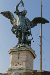 Close-up of Saint Michael sculpture at the top of Sant'Angelo Castle at Rome against a clear blue sky