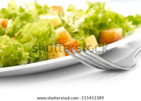 Close-up of salad on white plate