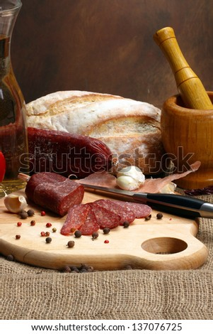 Close up of salami sausage on kitchen table
