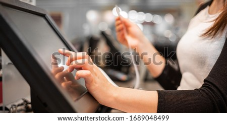 Close up of saleswoman hands accounting, billing some goods for sale, finance concept