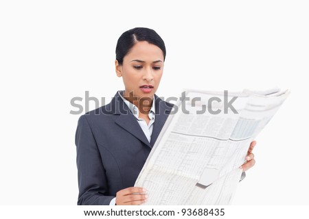 Close up of saleswoman reading news paper against a white background