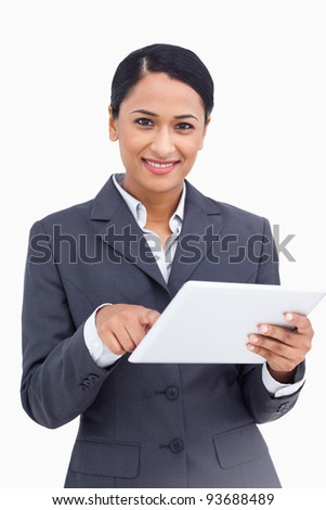 Close up of saleswoman using touch screen computer against a white background
