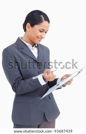 Close up of saleswoman with clipboard and pen against a white background
