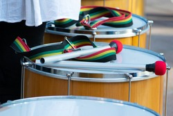 Close up of samba drum musicians at a street party carnival