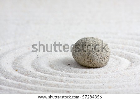 Close up of sand zen garden with stone