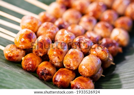 Close up of sausage grilled Thai traditional style, Sai krok isan, pork and rice, thai street food market Zdjęcia stock ©