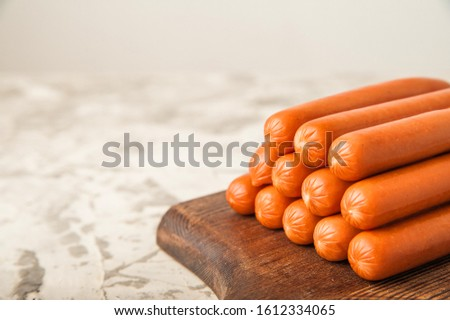 Close-up of sausages. Sausages on the blackboard and place for text. Boiled raw bavarian sausages and copy space. Stock photo ©