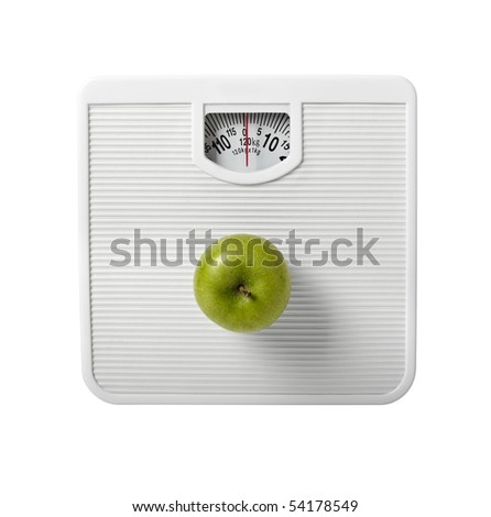 close up of scale and apple on white background with clipping path