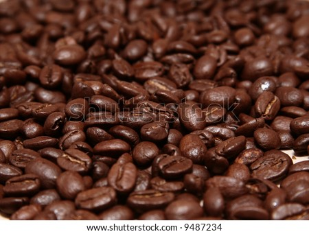 Close up of scattered coffee beans. - stock photo