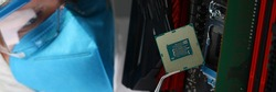 Close-up of scientist in uniform testing computer technology. Professional developer developing server. Microelectronics design. Repair and maintenance concept