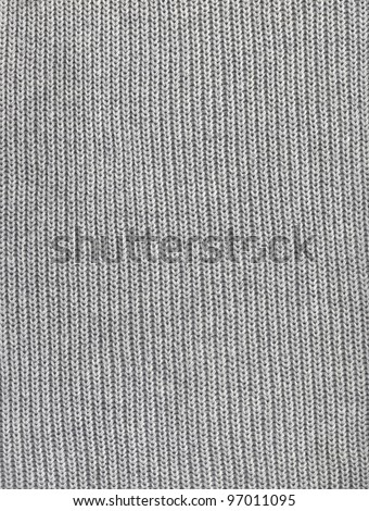 Close-up of seamless gray knitted fabric texture.
