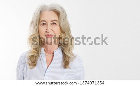 Close up of senior woman face isolated on white background. Happy old lady with wrinkled skin. Health care and wrinkles concept. Mature female. Copy space. Banner