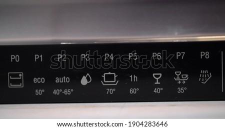 Close up of sensor panel of modern dishwasher. Cropped shot of stylish dishwasher control panel. Program buttons on dishwashing machine