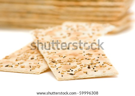 Close up of sesame crackers over white background