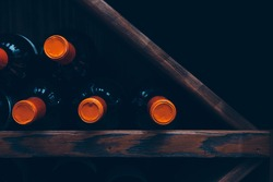 Close-up of several bottles of wine in row. Useful as a background